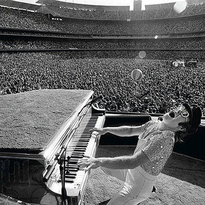 Elton John at the Dodgers Stadium Howling - Black and White - Los Angeles 1975  by Terry O Neill