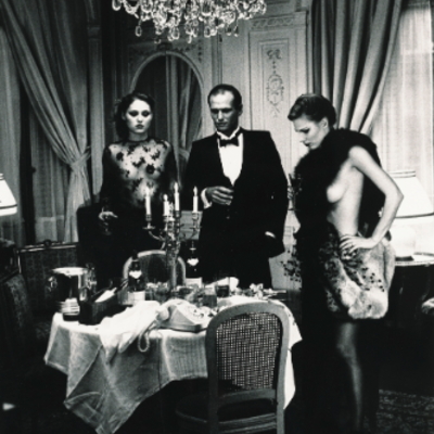 Dinner Party - Hotel Suite by Helmut Newton
