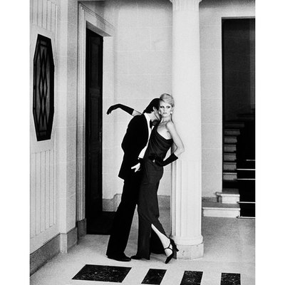 Man Kissing Woman in Hall by Helmut Newton
