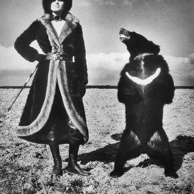 Model in Fur Coat and Bear by Helmut Newton