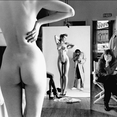 Self Portrait with Wife and Models by Helmut Newton
